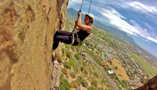 Alla Rockclimbing with Table Mountain in the background